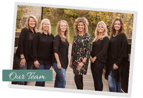 Ames Dentist Dr. Amie Rockow-Nelson with team